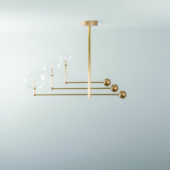 Brass universe chandelier schwung home treniq 6 1544789286813