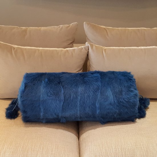Electric blue kid skin cushion with pom poms